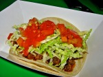 Naturally-Raised Angus Beef Taco with Cheddar, Green Cabbage and Vine-Ripened Tomato