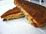Reuben Grilled Cheese with naturally raised corned beef brisket, sauerkraut and dressing