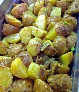 Lyonnaise Potato Salad: Local Butterball Potatoes, Olive Oli, White Wine Vinegar, White Wine, Coarse Mustard, Garlic ScapesCoarse Mustard