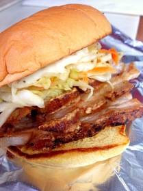 Crispy Skin Pork Belly Sandwich: Naturally Raised Pork Belly, Sweet and Sour Cabbage Slaw, Roasted Garlic Aioli.